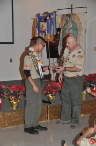 Scoutmaster hands over Senior Patrol Leader to Samaniego