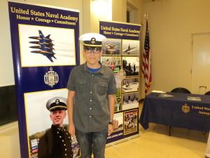 Samaniego wearing Midshipman Hat at Service Academy Night