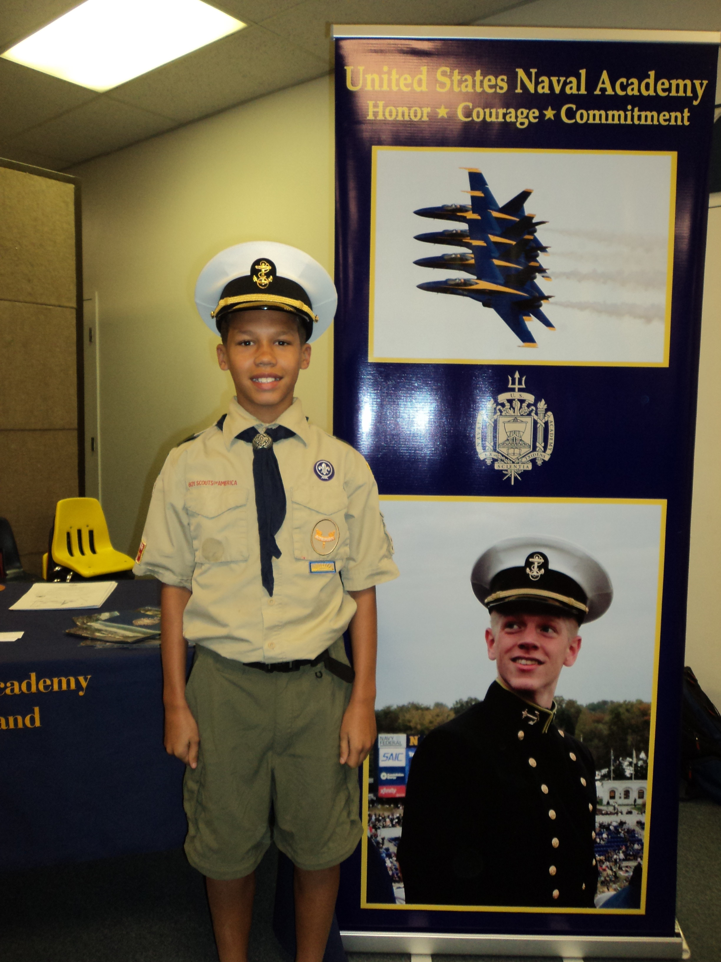 Roman looks sharp with the Midshipman Cover. Is he the next one to go to Naval Academy?