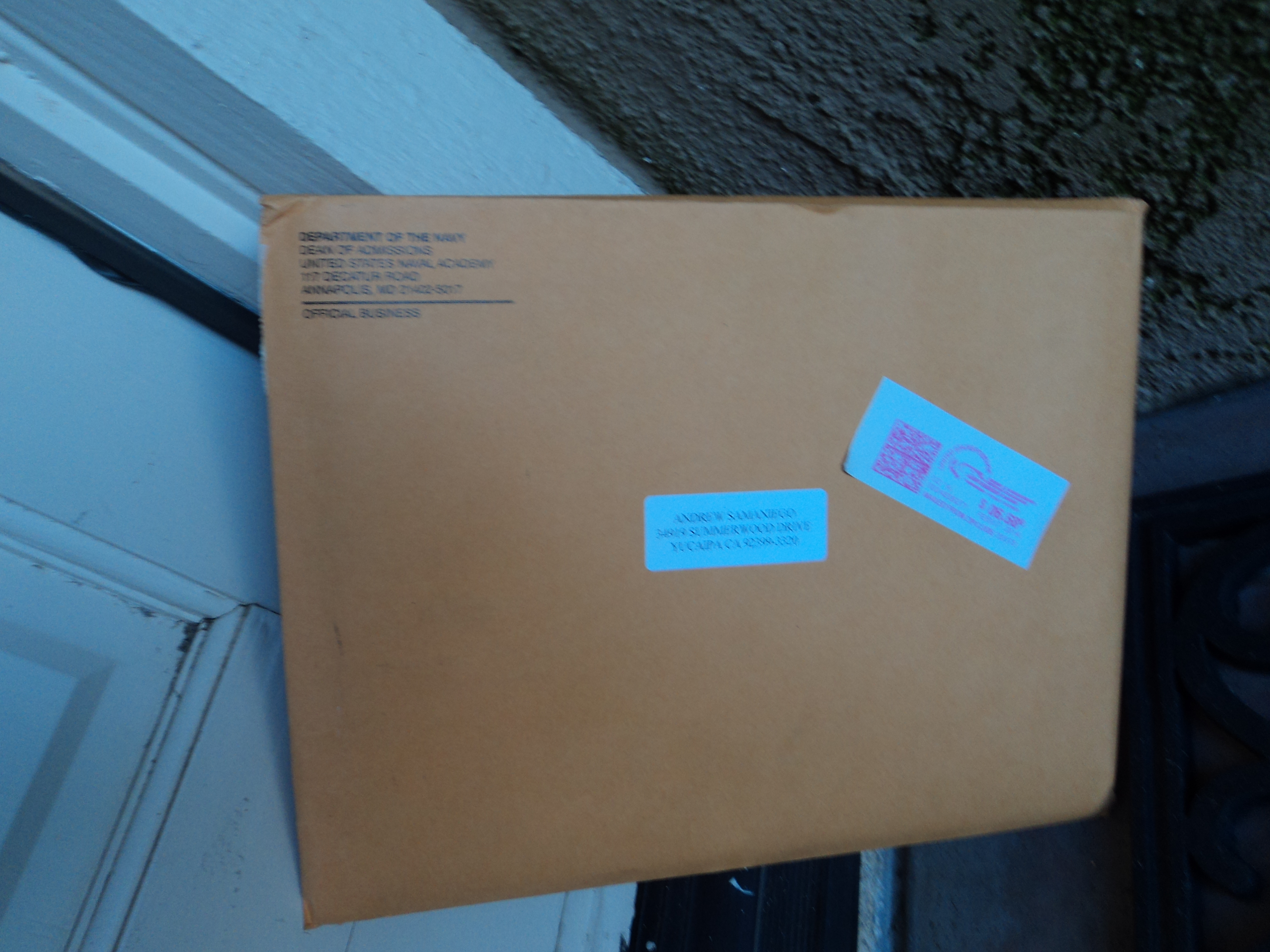 The BFE (Big Fat Envelope) sitting at the front door